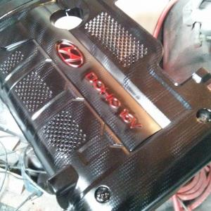 carbon and red engine cover